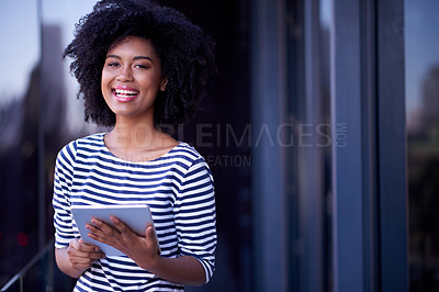 Buy stock photo Portrait of a young designer using a digital tablet outside an office