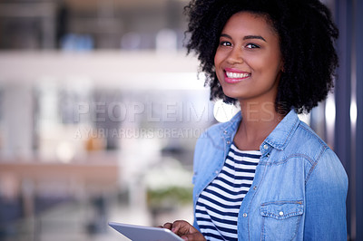 Buy stock photo Portrait of a young designer using a digital tablet in an office