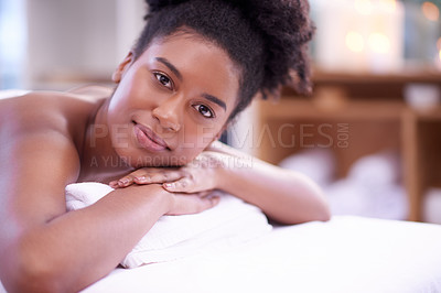 Buy stock photo Portrait of a young woman relaxing on a massage bed at a spa