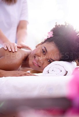 Buy stock photo Portrait of a young woman getting  a back massage at a spa