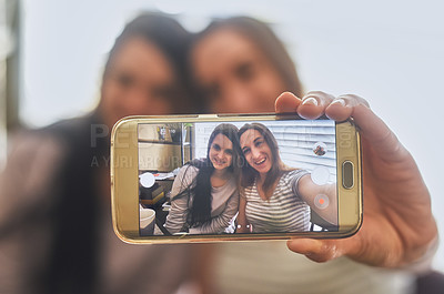 Buy stock photo Cropped shot of a two young women taking a picture in the morning at home