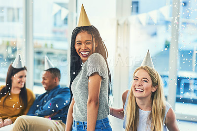 Buy stock photo Cropped portrait of two attractive young women celebrating a birthday with their friends