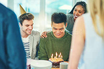 Buy stock photo Cropped shot of a young group of friends celebrating at a birthday party together