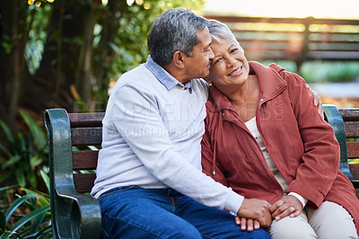 Buy stock photo Shot of a mature couple spending quality time together at the park