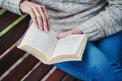 Buy stock photo Cropped shot of a senior woman reading a book and relaxing in the park
