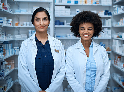 Buy stock photo Portrait of two confident young women working in a pharmacy
