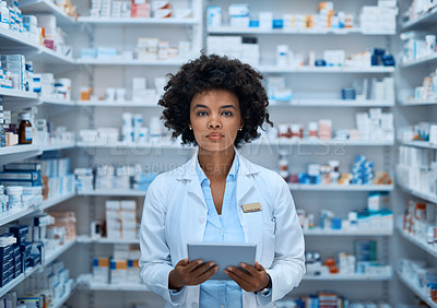 Buy stock photo Portrait of a confident young pharmacist holding a digital tablet in a chemist