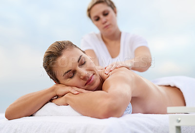 Buy stock photo Cropped shot of a woman getting a back massage at a day spa