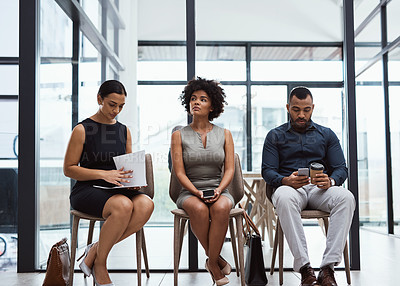 Buy stock photo Shot of businesspeople waiting in line in an office