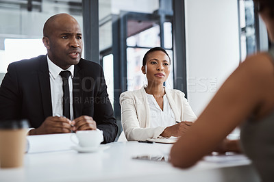 Buy stock photo Shot of businesspeople conducting an interview in an office