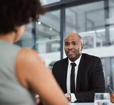 Buy stock photo Shot of a businessman conducting an interview in an office