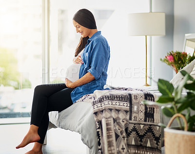 Buy stock photo Shot of a pregnant woman relaxing at home