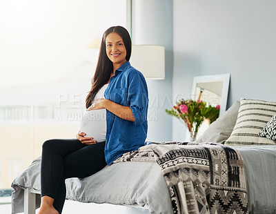 Buy stock photo Portrait of a pregnant woman relaxing at home