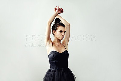 Buy stock photo Cropped shot of an attractive young female interpretive dancer practicing in her dance studio