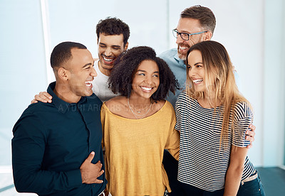 Buy stock photo Cropped shot of a group of creative businesspeople standing together in their modern office
