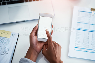 Buy stock photo Cropped shot of a businesswoman using a mobile phone at her desk in an office