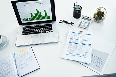 Buy stock photo High angle shot of a desk with various items on it in a financial company