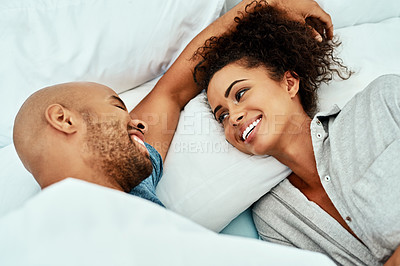 Buy stock photo Cropped shot of an affectionate young couple in their bedroom