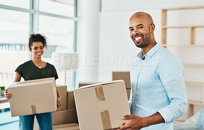 Buy stock photo Portrait of a couple young carrying boxes while moving house