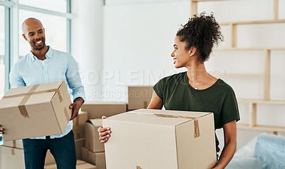 Buy stock photo Shot of a couple young carrying boxes while moving house