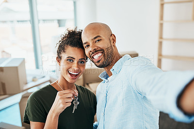 Buy stock photo Portrait of a young couple taking a selfie while holding the keys to their new home