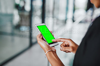 Buy stock photo Closeup shot of an unrecognizable businesswoman using a cellphone with a green screen in an office