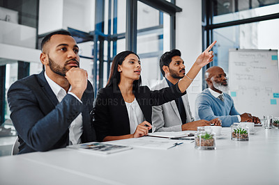 Buy stock photo Shot of a panel of businesspeople giving feedback during a presentation in an office