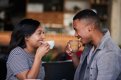 Buy stock photo Shot of a young couple having coffee on a date in a cafe