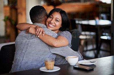 Buy stock photo Portrait of a young couple hugging on a date in a cafe