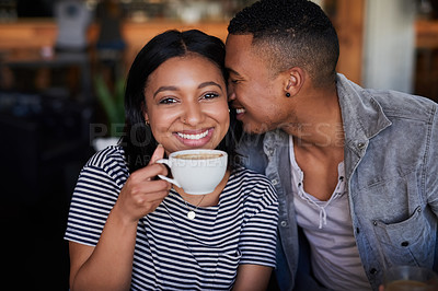 Buy stock photo Portrait of an affectionate young couple having coffee on a date in a cafe