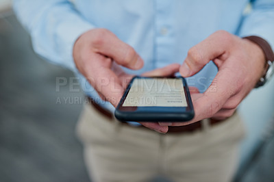 Buy stock photo Closeup shot of a businessman using a cellphone in an office