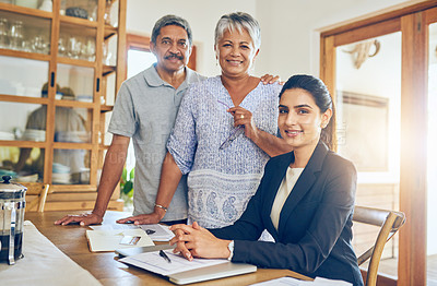 Buy stock photo Portrait of a mature couple getting advice from their financial consultant at home