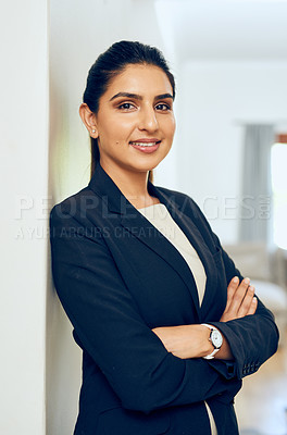 Buy stock photo Portrait of a young woman standing in an office