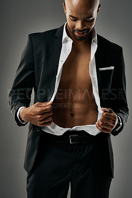 Buy stock photo Studio shot of a stylish and sexy businessman against a gray background