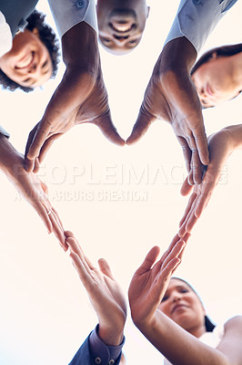 Buy stock photo Closeup shot of a group of unrecognizable businesspeople making a heart shape with their hands outdoors