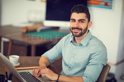 Buy stock photo Portrait of a young businessman working at the office
