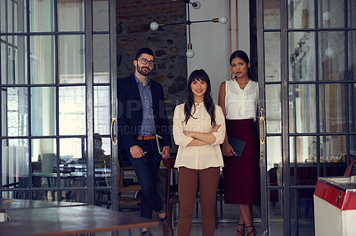 Buy stock photo Portrait of a group of businesspeople standing in an office