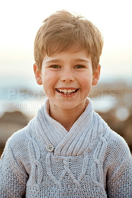 Buy stock photo Cropped portrait of an adorable little boy standing on the beach