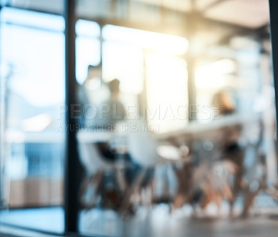Buy stock photo Defocused shot of a group of businesspeople having a meeting in an office