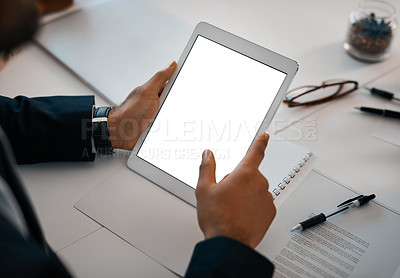 Buy stock photo Closeup shot of an unrecognizable businessman using a digital tablet with a blank screen in an office