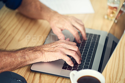 Buy stock photo Cropped shot of an unrecognizable businessman working from home