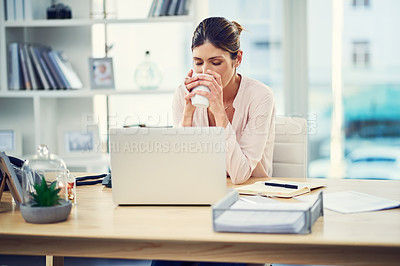 Buy stock photo Shot of an attractive young businesswoman working from home