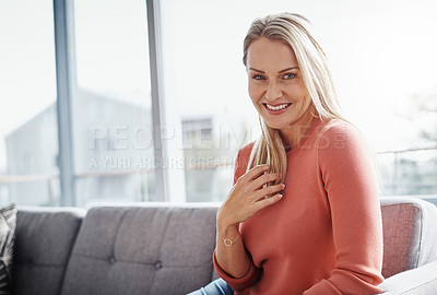 Buy stock photo Portrait of an attractive mature woman relaxing on the sofa at home