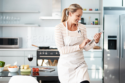 Buy stock photo Shot of a mature woman in her kitchen