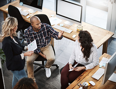 Buy stock photo High angle shot of a group of businesspeople having a discussion in an office