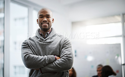 Buy stock photo Shot of a young businessman standing in an office