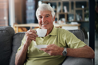 Buy stock photo Portrait of a senior man enjoying a beverage while relaxing on the sofa at home