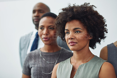 Buy stock photo Cropped shot of a group of businesspeople standing in line in their corporate office
