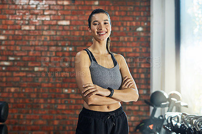 Buy stock photo Portrait of a confident young woman in a gym