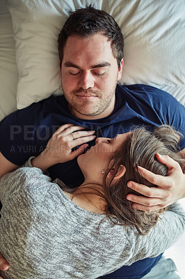 Buy stock photo High angle shot of a young couple sleeping peacefully together in bed